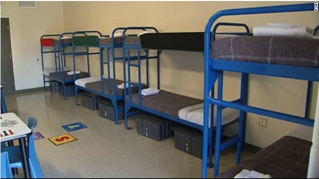 An eight-person room at the Karnes County detention center is shown on July 31, 2014.