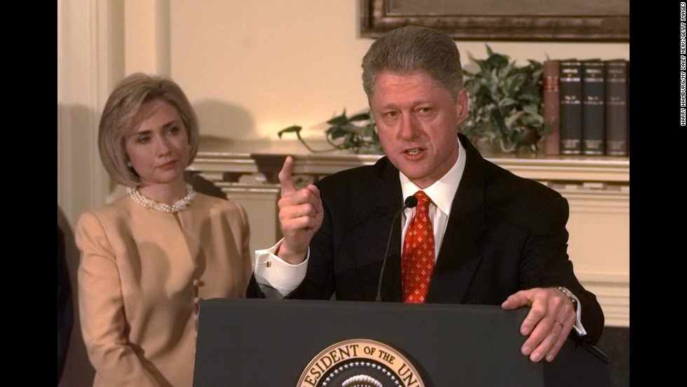 "President Clinton speaks about the Monica Lewinsky scandal at the White House on January 26, 1998, as First Lady Hillary Clinton looks on. ""I did not have sexual relations with that woman,"" he said."