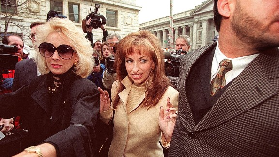 "Paula Jones, center, arrives at the office of a lawyer representing Clinton in January 1998. The former Arkansas state employee filed a federal civil lawsuit in 1994 accusing Clinton of making ""persistent and continuous"" unwanted sexual advances during a conference in 1991, when he was governor. The President agreed to an $850,000 settlement in November 1998."