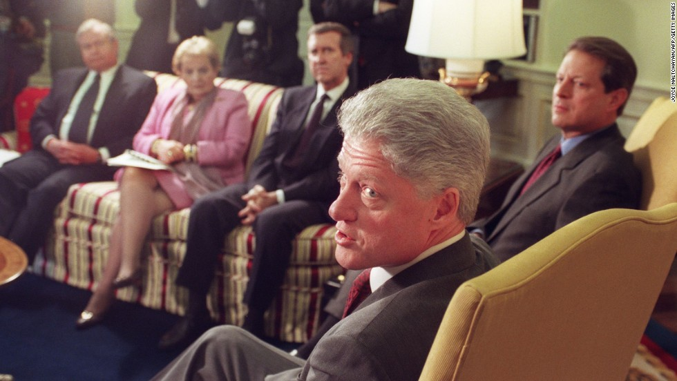 Clinton answers questions from reporters on December 17, 1998, before the start of a meeting with his foreign policy team, including National Security Adviser Sandy Berger, left, Secretary of State Madeleine Albright, Defense Secretary William Cohen and Vice President Al Gore at the White House. After a December 16 military strike on Iraq, Clinton warned Iraqi President Saddam Hussein against threatening his neighbors. Clinton also indicated his determination to complete the operations that continued the next day with renewed bombing of Iraqi sites suspected of housing parts to manufacture weapons of mass destruction.