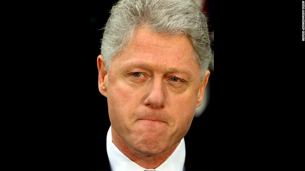 "Clinton pauses while reading a statement in the Rose Garden of the White House after the Senate voted to acquit him on February 12, 1999, in Washington. Clinton apologized for the actions that led to his impeachment, saying he was ""profoundly sorry."""