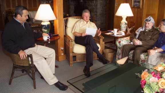 Clinton meets with Israeli Prime Minister Ehud Barak, left, and Palestinian Authority Chairman Yasser Arafat at Maryland's Camp David in July 2000. It was at the end of a Mideast peace summit. The talks ended without an agreement.