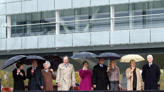 Clinton attends the inauguration of his presidential library and museum in Little Rock, Arkansas, in November 2004. Clinton was joined, from right, by his wife, his daughter, former President George W. Bush, first lady Laura Bush, former President George H.W. Bush, former first lady Barbara Bush, former President Jimmy Carter and former first lady Rosalynn Carter.
