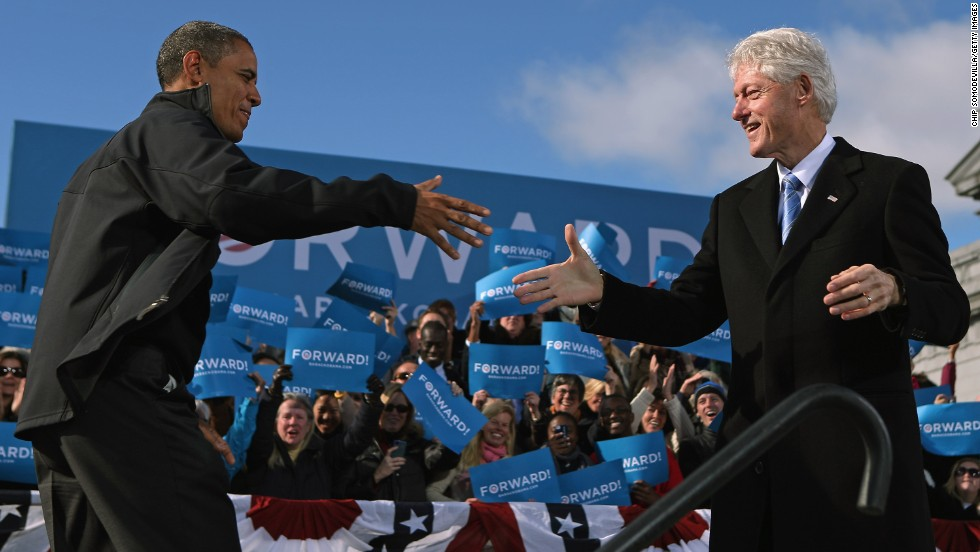 "Clinton welcomes President Barack Obama to the stage during a campaign rally on November 4, 2012, in Concord, New Hampshire. With only two days left until the presidential election, Obama and his opponent, former Massachusetts Gov. Mitt Romney, were stumping from one ""swing state"" to the next in a last-minute rush to persuade undecided voters."