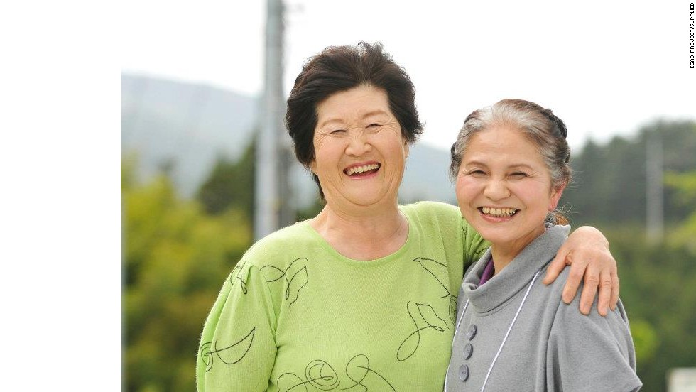 One of Asama's most treasured images: These women met for the first time on the day an Egao Project photographer captured this picture in May 2011. They have since become close friends.