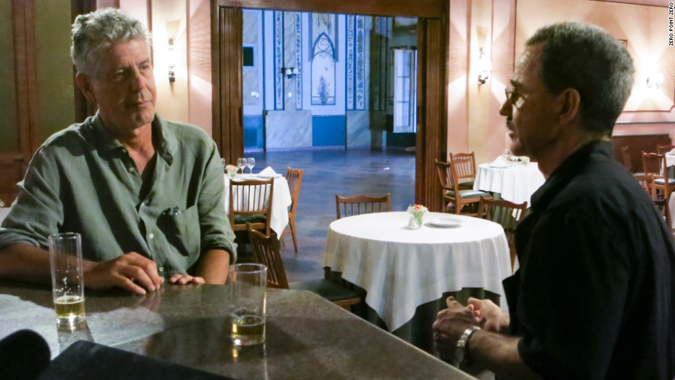 Bourdain sits down in the historic dining room of the Gran Hotel Paraguay with writer Guido Rodriguez Alcala.