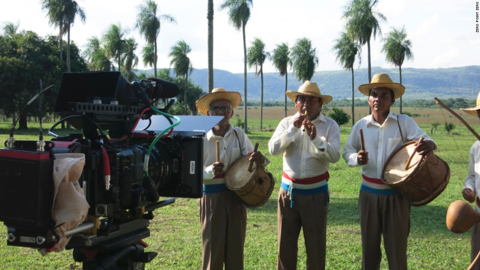Bourdain's crew films a traditional guarani band at the ranch.