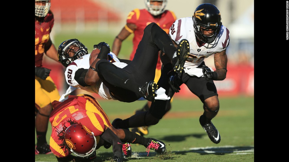 Arizona State running back Kalen Ballage goes horizontal after a hit from USC cornerback Kevon Seymour on Saturday, October 4.