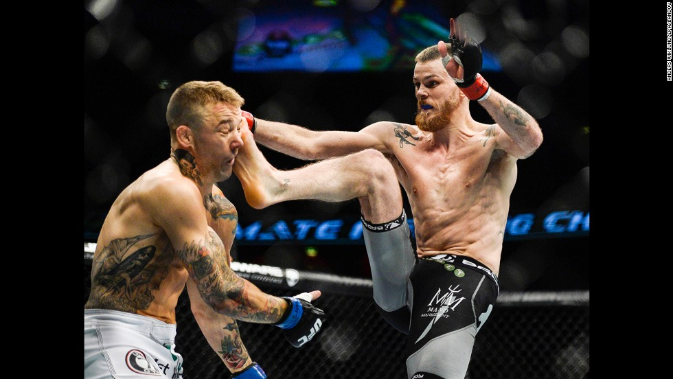 Niklas Backstrom kicks Mike Wilkinson in the head during the first round of their featherweight bout Saturday, October 4, at UFC Fight Night 53. But Wilkinson knocked out Backstrom just a few moments later to disappoint a pro-Backstrom crowd in Stockholm, Sweden.