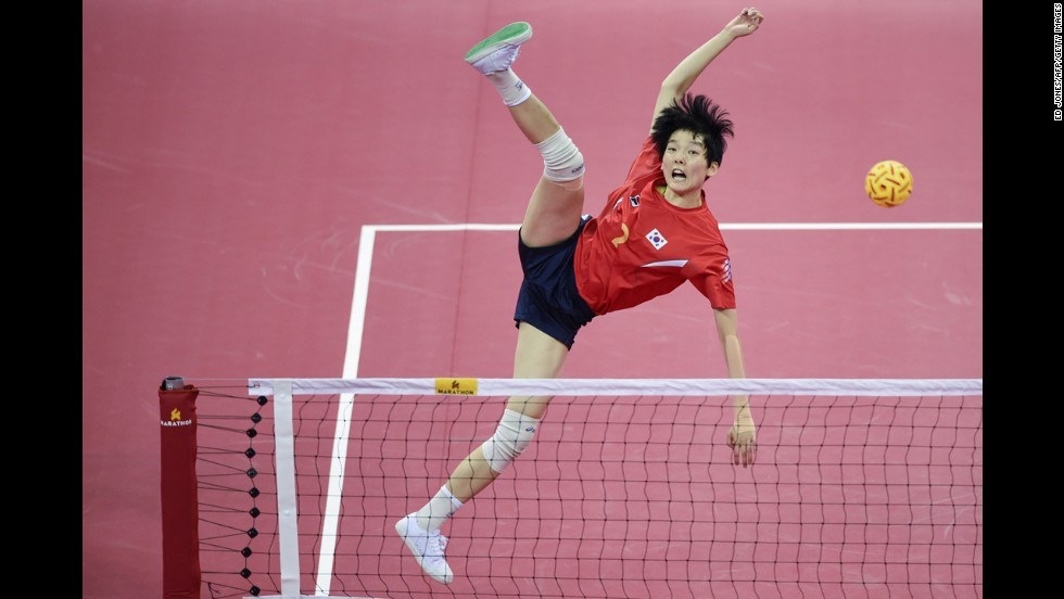 Kim Is-eul of South Korea jumps for the ball Friday, October 3, while she plays in the sepak takraw final at the Asian Games in Incheon, South Korea. Thailand defeated South Korea to win the gold.