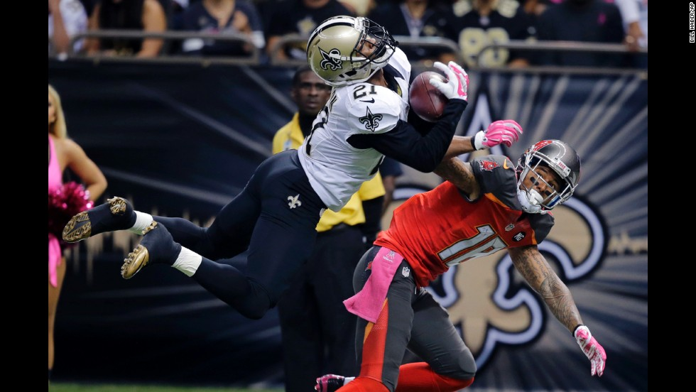 New Orleans cornerback Patrick Robinson intercepts a pass that was intended for Tampa Bay wide receiver Louis Murphy on Sunday, October 5, in New Orleans.