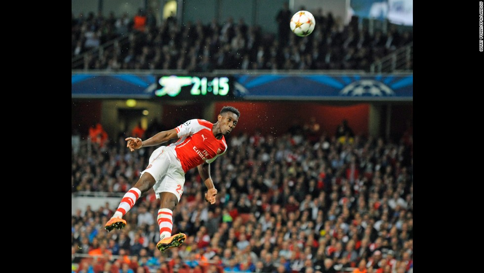 Arsenal forward Danny Welbeck heads a ball during the London team's 4-1 home win over Galatasaray in the UEFA Champions League on Wednesday, October 1. Welbeck scored a hat trick in the game, his first for the club.