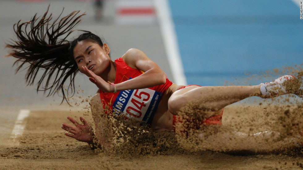 China's Li Yanmei competes in the triple jump Wednesday, October 1, at the Asian Games in Incheon, South Korea. She finished fourth in the event, which was won by Kazakhstan's Olga Rypakova.