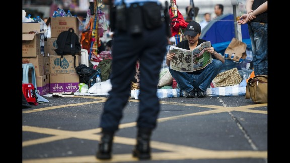 A pro-democracy protester reads a newspaper in Hong Kong