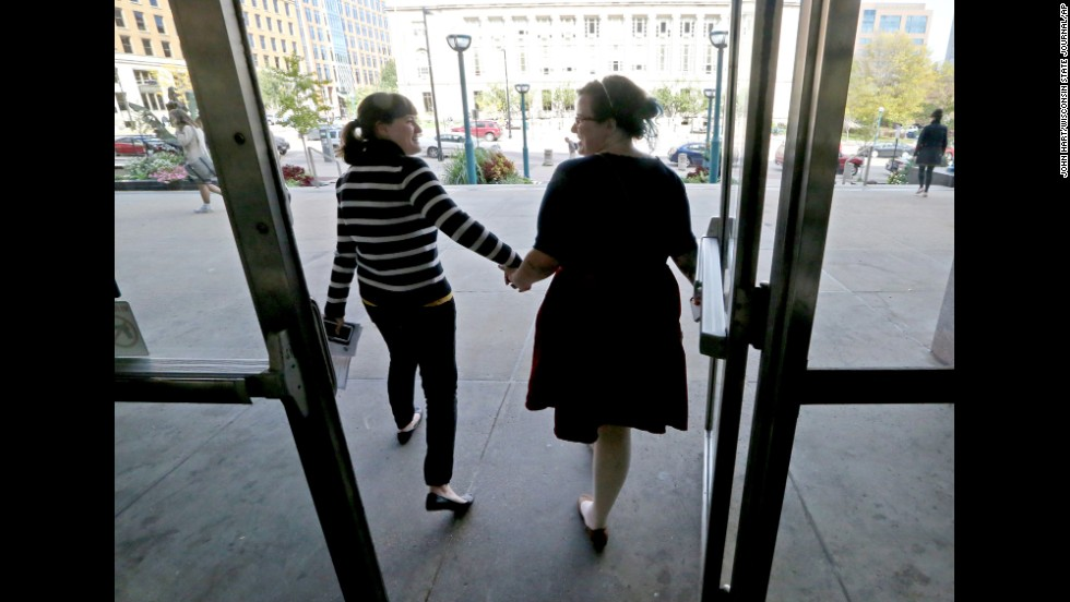 Abbi Huber, left, and Talia Frolkis exit the City County Building in Madison, Wisconsin, after applying for a marriage license on October 6, 2014.