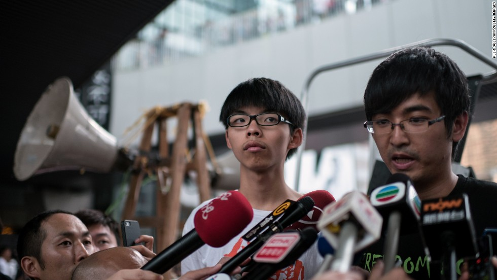 "Student leaders Joshua Wong, left, and Alex Chow helped launch the current protests. They are demanding ""real democracy"" for Hong Kong."