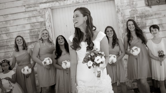 Brittany Maynard shares a moment with her bridesmaids on her wedding day.
