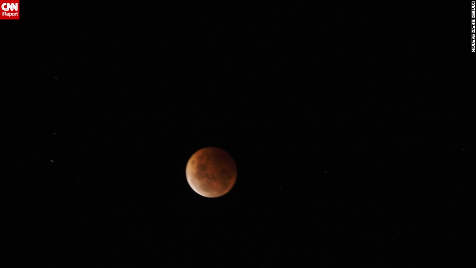 "On the other side of the world, the blood moon appeared at night. <a href=""http://ireport.cnn.com/docs/DOC-1177239"">Hayden Himburg</a> saw the eclipse from Dunedin, New Zealand, Wednesday just before midnight.  ""I have seen previous blood moons, and they are always impressive,"" he said."