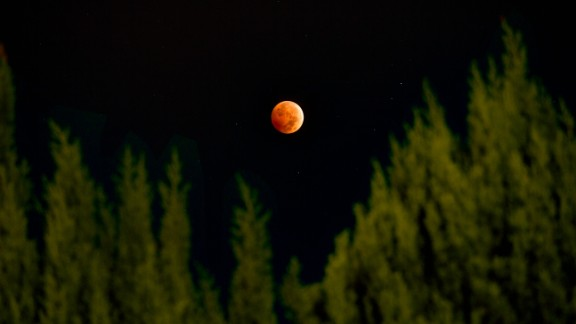 "Paulo Solano combined three different exposures using HDR photography to create this beautiful image from Van Nuys, California, of the October 2014 lunar eclipse. The second ""blood moon"" of the year could be witnessed throughout North America, as well as over most of the Pacific and much of East  Asia."