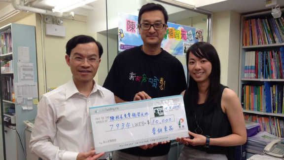 Successful campaigners take a cheque for HK$10,000 (US$1,300). Yim says that even small donations of this type can make a big difference to many charities.