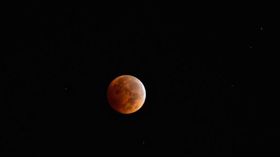 "Bob Cozzi got up early to see the blood moon over North Aurora, Illinois, at 6 a.m. on Wednesday. ""With the clear sky, it feels like you're on another planet,"" Cozzi said."