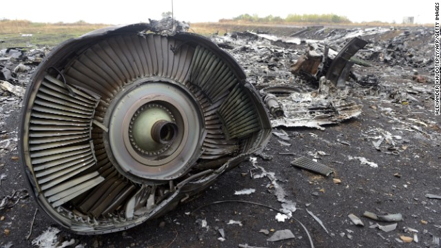 Debris from MH17 sits in a field at the crash site in Ukraine on September 9, 2014.