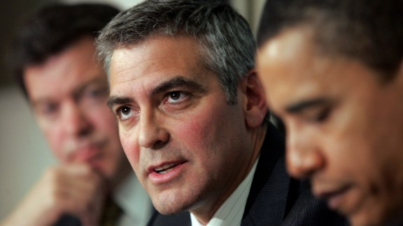 WASHINGTON - APRIL 27:  Actor George Clooney (C) answers a question during The National Press Club Newsmaker's Program April 27, 2006 in Washington, DC. Clooney joined Sen. Sam Brownback (L) (R-KS) and Sen. Barack Obama (R) (D-IL) in discussing the current situation in the Darfur region of Sudan and also held a news conference regarding Clooney's recent visit to the Darfur.  (Photo by Win McNamee/Getty Images)
