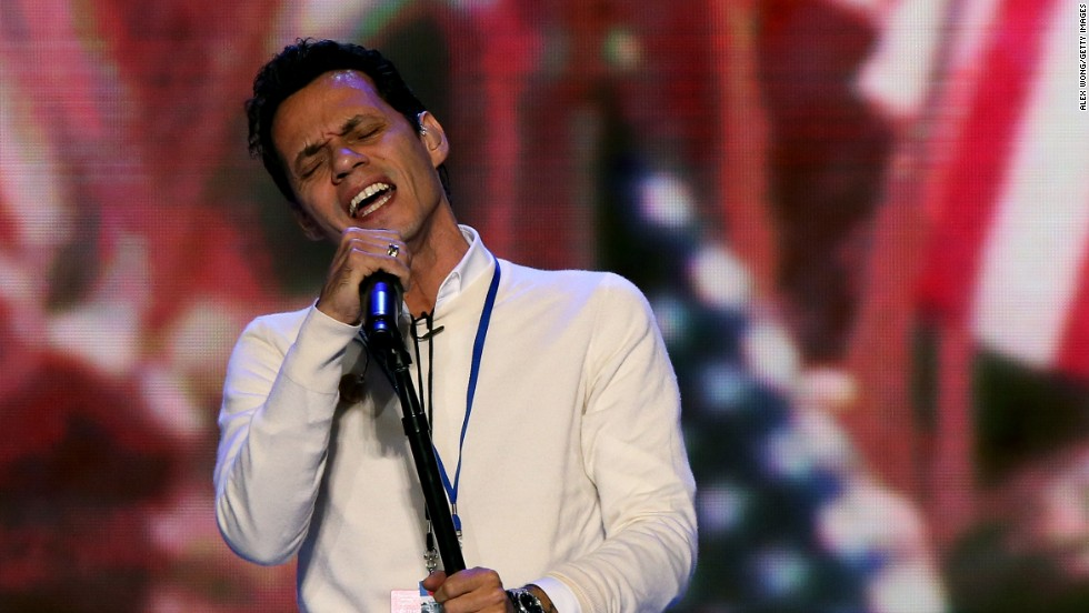 Musician Marc Anthony held a fundraiser for Obama in Miami in the summer of 2012. In this photo, he's performing for a sound check during the final day of the Democratic National Convention that year in Charlotte, North Carolina.