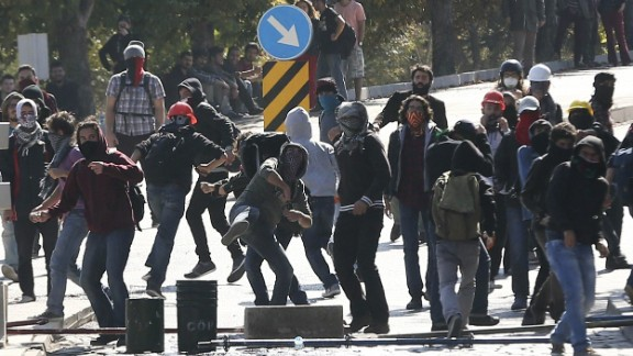 Demonstrators clash with riot police outside of the Middle Eastern Technical University (METU) in Ankara on October 9, 2014 to denounce Turkey