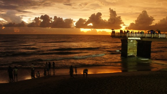 A warm sunset settles over the Galle Face Green promenade in the business district of Colombo, Sri Lanka. The ocean-side urban park is a popular destination for residents and tourists.