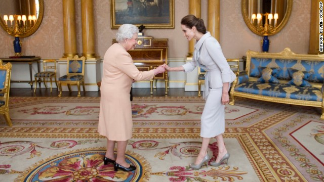 Angelina Jolie meets Queen Elizabeth as she is presented with the Insignia of an Honorary Dame Grand Cross of the Most Distinguished Order of St. Michael and St. George at Buckingham Palace on Friday.