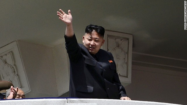 North Korea's leader Kim Jong-Un waves at the end of a 2012 military parade to mark 100 years since the birth of his grandfather Kim Il-Sung.