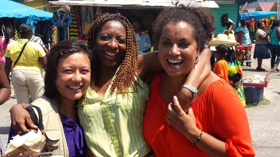 Pereira shops at the MoBay Craft Market with producer Marlei Martinez, left, and new friend Janet Silvera.