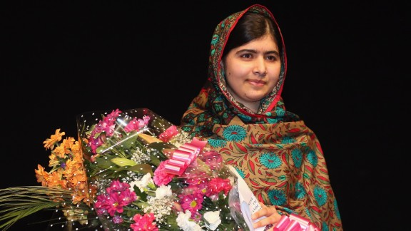 Malala Yousafzai poses on stage in Birmingham, England, after she was announced as a recipient of the Nobel Peace Prize on Friday, October 10, 2014. Two years earlier, she was shot in the head by the Taliban for her efforts to promote education for girls in Pakistan. Since then, after recovering from surgery, she has taken her campaign to the world stage.