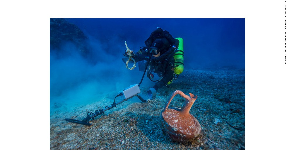 "After spending the last month at the historic wreck site, the <a href=""http://www.whoi.edu/news-release/antikythera-finds"" target=""_blank"">Woods Hole Oceanographic Institute</a> (WHOI) announced that an international team of archaeologists had recovered new items from the Antikythera wreck. Pictured, Greek technical diver Alexandros Sotiriou discovers an intact ""lagynos"" ceramic table jug and a bronze rigging ring. The new items have indicated the wreck site is much bigger than previously believed, scattered across 300 meters of seafloor."