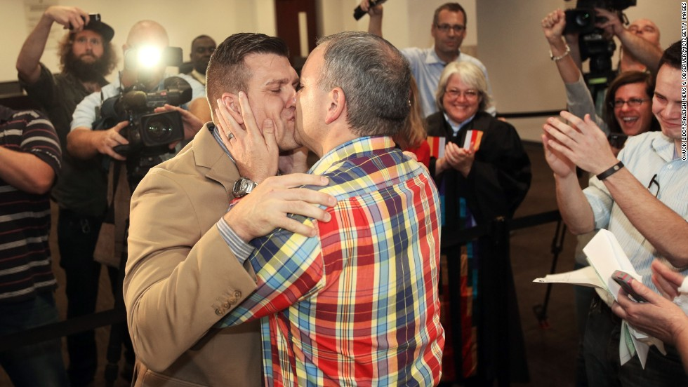 Chad Biggs, left, and Chris Creech say their wedding vows at the Wake County