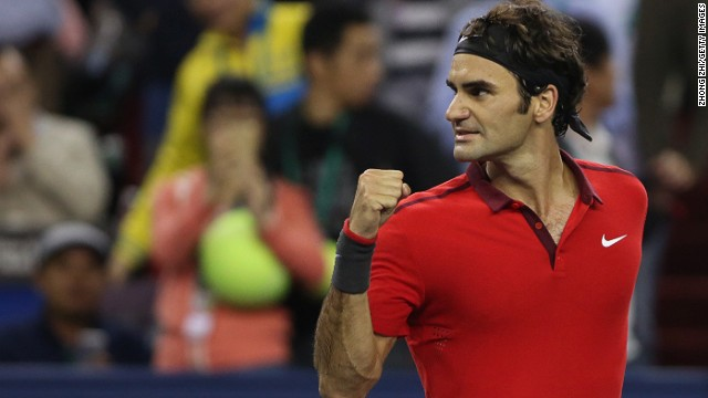 Roger Federer  reacts after winning his semifinal match against Novak Djokovic at the Shanghai Masters.
