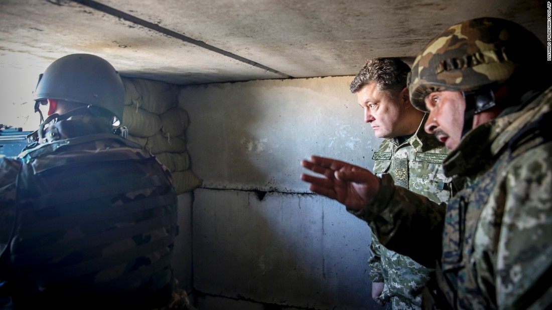 Ukrainian President Petro Poroshenko, center, inspects Ukrainian army positions close to Donetsk on Friday, October 10.