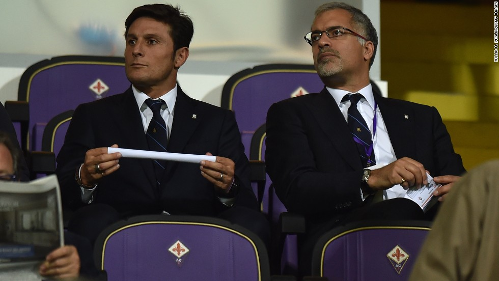 Inter's chief executive officer is Michael Bolingbroke, who previously worked for Manchester United, and is pictured sitting next to Inter vice-president Javier Zanetti.