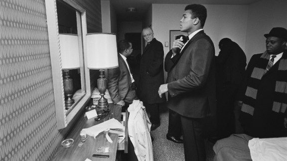 Ali looks in his hotel-room mirror in February 1967.