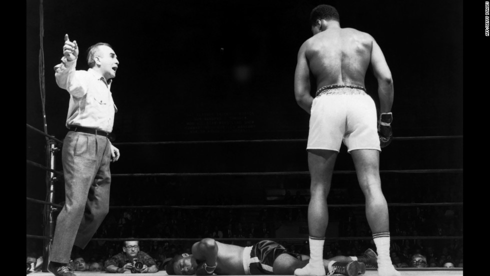 The referee counts as Ali looks down at Zora Folley during a championship fight in New York on March 23, 1967. Ali won by a knockout in the seventh round.