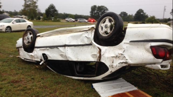 A car is damaged after severe weather passed through Little River County, Arkansas, on Monday.