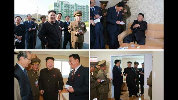 """The North Korean leader gave """"field guidance"""" to a newly built residential district, state news agency KCNA reported. Here, Kim appears with officials while walking with a cane."""