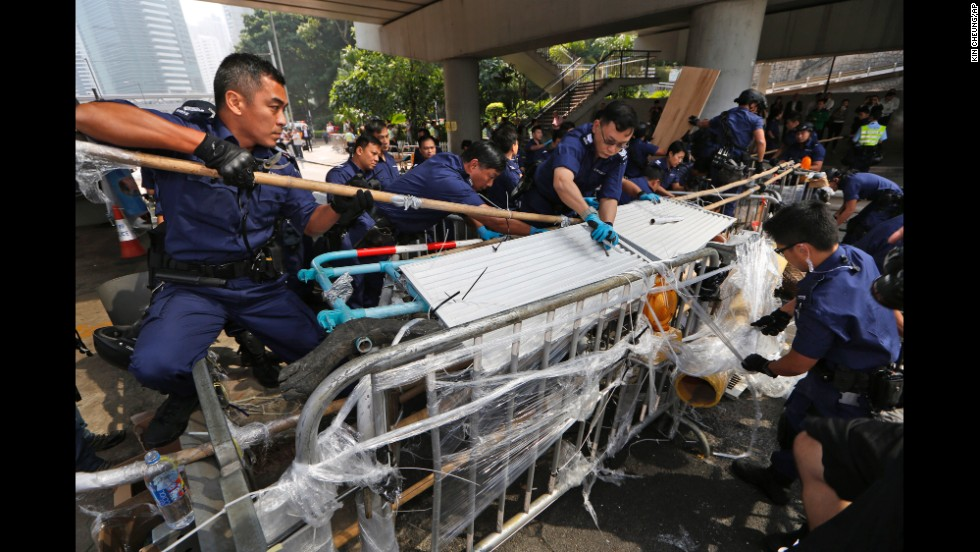 Police dismantle barricades from the streets on October 14.