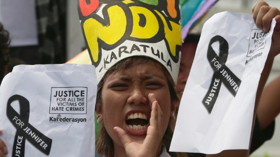 A protester takes part in a rally at the U.S. Embassy in Manila, Philippines, on October 14, 2014, to condemn the killing of a Filipino transgender woman.
