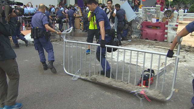 Police tear down Hong Kong barricades