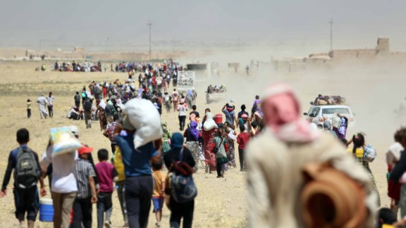Thousands of Yazidis are escorted to safety by Kurdish Peshmerga forces and a People