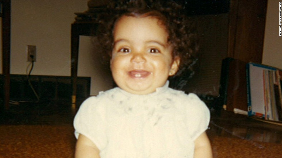 Here is CNN's Michaela Pereira when she was 1 year old in Saskatoon, Saskatchewan. Pereira has two family trees. The one she knows well belongs to her adoptive, Canadian parents. The other, less understood one is rooted in the place her ancestors came from, St. James Parish in Jamaica.