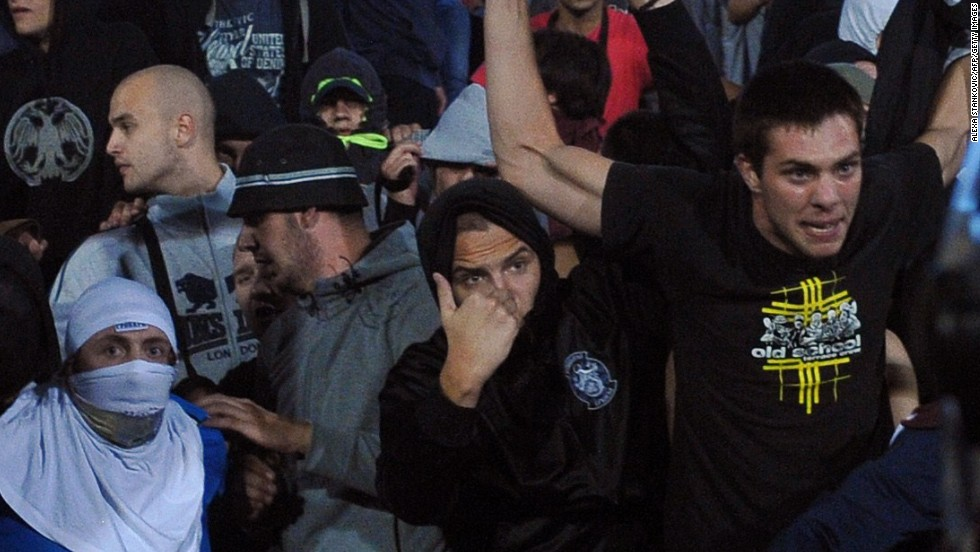 Angry fans gesture toward the field after the drone incident and subsequent melee.