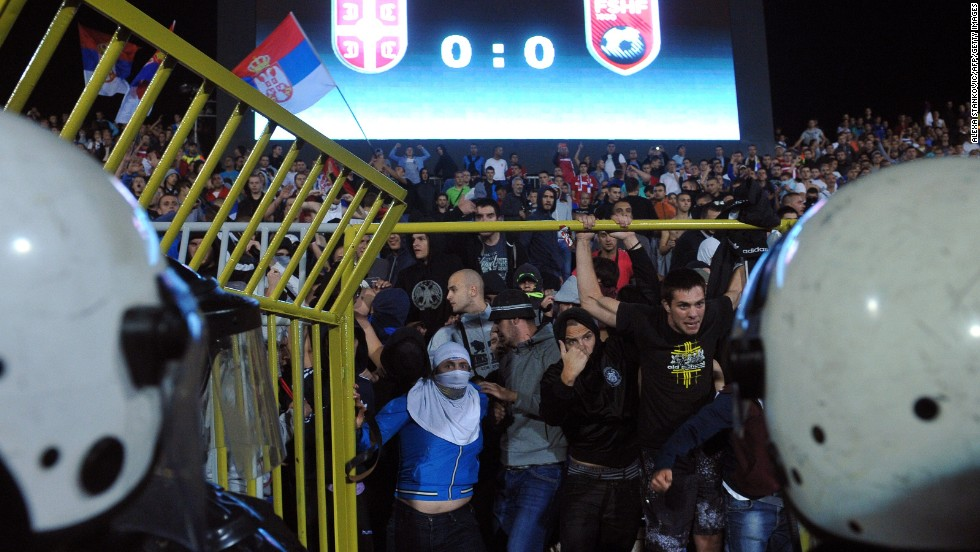 Riot police stand off against Serbian supporters as the situation escalates.